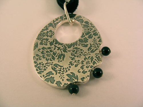 Silver Oval Pendant with Onyx Beads