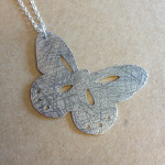 Lovely combination of random texture and precise piercing on the butterfly pendant made by Jenni.